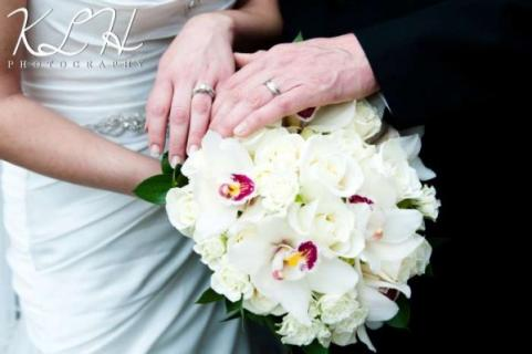 White Cymbidium Orchids and Tibet Roses